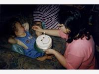 Elaine feeding Demi