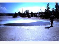 Dr Nigel H. Trewin at Cinder Pool, Norris Geyser Basin, Yellowstone National Park, August 1999.
